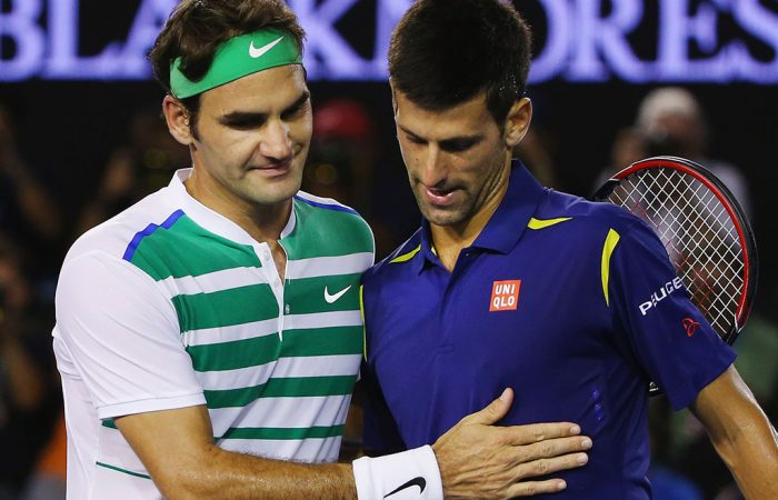 Roger Federer (L) and Novak Djokovic meet at net after their Australian Open 2016 semifinal; Getty Images