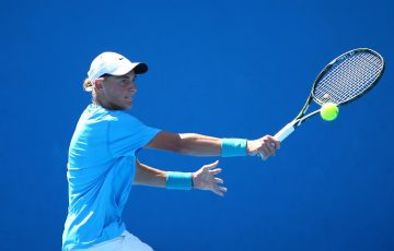 MELBOURNE, AUSTRALIA - JANUARY 24:  Max Purcell of Australia plays a backhand in his first round match against Toru Horei of Japan during the Australian Open 2016 Junior Championships at Melbourne Park on January 24, 2016 in Melbourne, Australia.  (Photo by Jack Thomas/Getty Images)