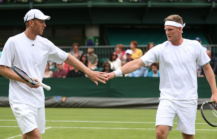 Chris Guccione (L) and Sam Groth in doubles action; Getty Images