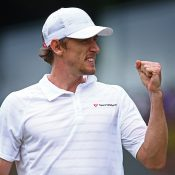 John Millman celebrates a point during his victory over 26th seed Benoit Paire at Wimbledon; Getty Images