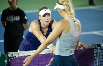 Sam Stosur chats with Caroline Wozniacki at net after the Dane retired from their second-round match in Washington DC; photo credit ©Citi Open