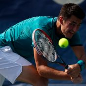 Bernard Tomic stretches for a backhand during his loss to Ivo Karlovic in the third round at the Citi Open in Washington DC; Getty Images