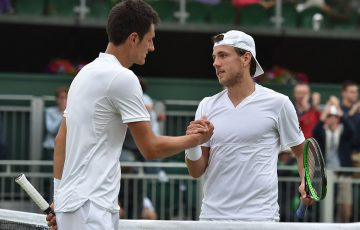 Bernard Tomic (L) shakes hands with Lucas Pouille after a five-set fourth-round loss to the Frenchman at Wimbledon; Getty Images