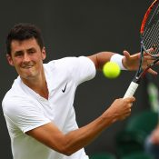 Bernard Tomic in action on his way to a four-set victory over qualifier Radu Albot in the second round at Wimbledon; Getty Images