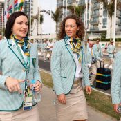 Sam Stosur (R) walks with Australian cyclist and flag-bearer Anna Meares; Getty Images