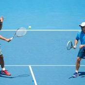 Andrew Florent (left) played with Josh Eagle during the Australian Open 2014 legends event; Getty Images