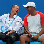 Andrew Florent (R) shares a laugh with Lleyton Hewitt during the Australian Open 2014 legends event; Getty Images