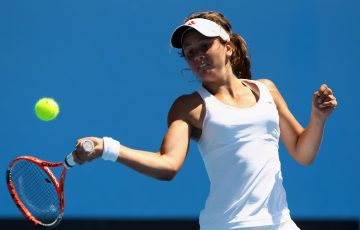 MELBOURNE, AUSTRALIA - JANUARY 23:  Samantha Harris of Australia plays a forehand in her first round juniors match against Ilona Kremen of Belarus during day seven of the 2011 Australian Open at Melbourne Park on January 23, 2011 in Melbourne, Australia.  (Photo by Quinn Rooney/Getty Images)