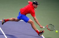 John Millman chases down a ball during his five-set loss to Dominic Thiem at the US Open; Getty Images