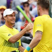 Onya mate! Hewitt celebrates with Groth. Photo: Getty Images