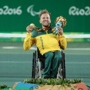 Dylan Alcott poses with his gold medal after winning the quads singles event at the Rio 2016 Paralympics; ITF Wheelchair Tennis