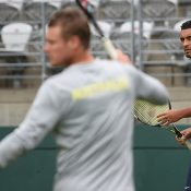 Nick Krygios (R) in a practice session overseen by captain Lleyton Hewitt; Getty Images
