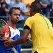 Nick Kyrgios (R) shakes hands with Andrej Martin after his victory in the opening singles rubber; Getty Images