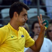 Bernard Tomic celebrates his victory in the second singles rubber over Jozef Kovalik; Getty Images
