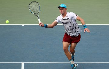 James Duckworth advances on the net during his second-round loss to Jo-Wilfried Tsonga at the US Open; Getty Images