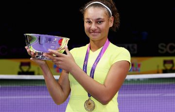 Violet Apisah poses with her trophy after winning the WTA Future Stars tournament in Singapore; Getty Images
