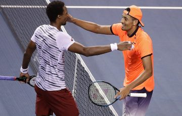 Nick Kyrgios (R) hugs Gael Monfils after winning their semifinal match in Tokyo; Getty Images