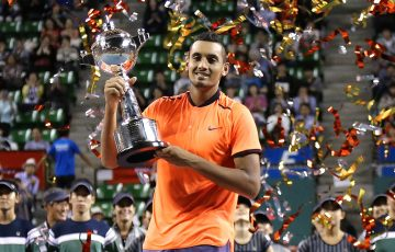 Nick Kyrgios celebrates his Japan Open title after beating David Goffin in the final in Tokyo; Getty Images