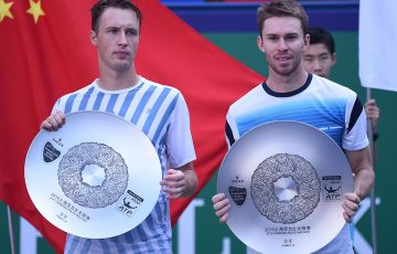 John Peers (R) and Henri Kontinen pose with their runners-up trophies after falling to John Isner and Jack Sock in the Shanghai Rolex Masters doubles final; Getty Images