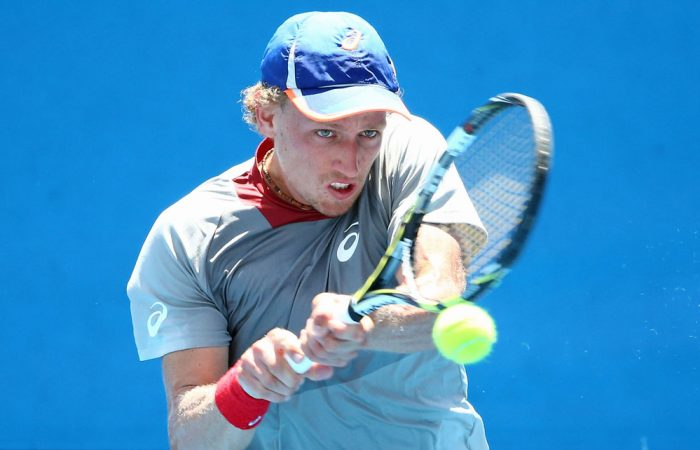 MELBOURNE, AUSTRALIA - DECEMBER 14:  Maverick Banes of Queensland plays a backhand during his 2016 Australian Open Men's Singles Play Off match against Marinko Matosevic of Victoria at Melbourne Park on December 14, 2015 in Melbourne, Australia.  (Photo by Scott Barbour/Getty Images)