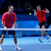 John Peers plays a forehand alongside Henri Kontinen at the ATP World Tour Finals; Getty Images