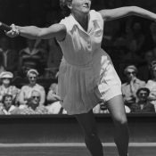 Australian tennis player Beryl (Penrose) Collier seen competing against Louise Brough in the 1955 Wimbledon quarterfinals; Getty Images