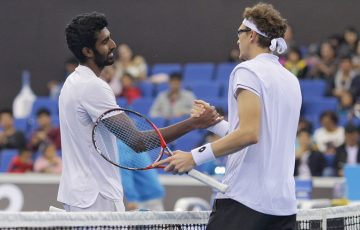 Denis Istomin (R) shakes hands with Prajnesh Gunneswaran after their thrilling semifinal at the AO Asia-Pacific Wildcard Play-off in Zhuhai, China; photo credit Zihao Qiu