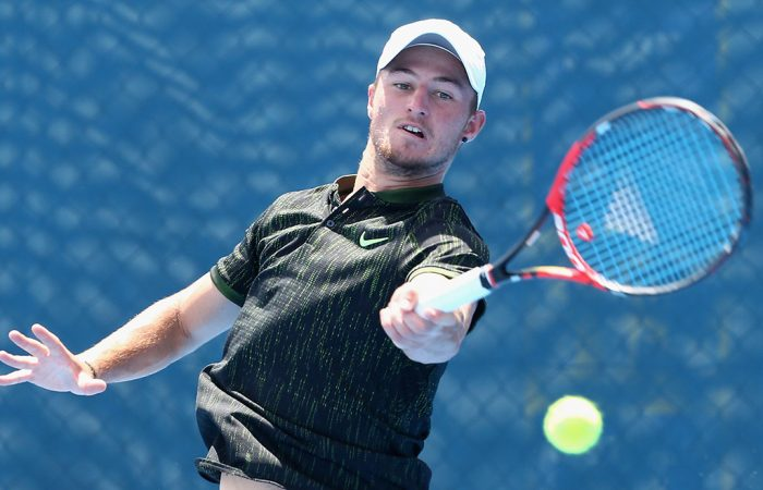 Omar Jasika in action during his first-round AO Play-off win over Marinko Matosevic; Getty Images