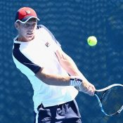 Andrew Whittington in action during his first-round AO Play-off match against Max Purcell; Getty Images