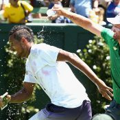 Nick Kyrgios gets a soaking. Photo: Getty Images