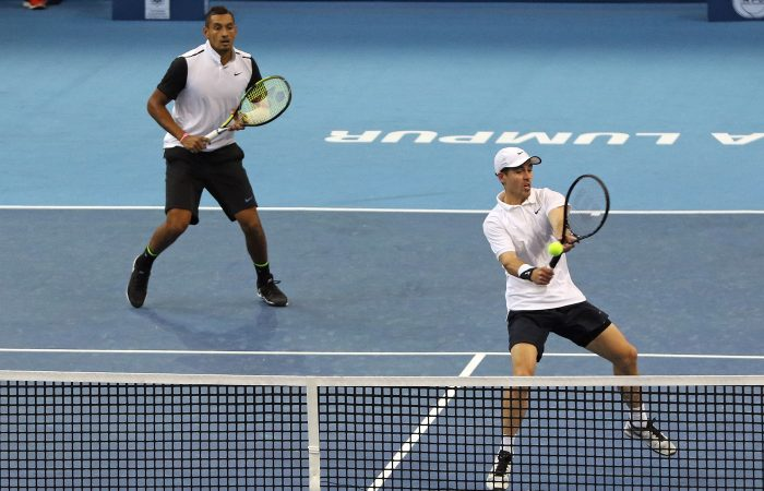 KUALA LUMPUR, MALAYSIA - SEPTEMBER 29:  James Frawley and Nick Kyrgios of Australia  competes against  Raven Klaasen of RSA and Rajeev Ram of USA  during the 2015 ATP Malaysian Open at Bukit Jalil National Stadium on September 29, 2015 in Kuala Lumpur, Malaysia.  (Photo by How Foo Yeen/Getty Images)