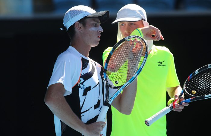 MELBOURNE, AUSTRALIA - JANUARY 26:  Marc Polmans and Andrew Whittington of Australia compete against Henri Kontinen of Finland and John Peers of Australia in their doubles semifinal match on day 11 of the 2017 Australian Open at Melbourne Park on January 26, 2017 in Melbourne, Australia.  (Photo by Pat Scala/Getty Images)