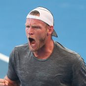 Sam Groth celebrates a winning point during his first-round match against Pierre-Hugues Herbert at the Brisbane International; Getty Images