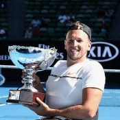 Dylan Alcott holds the Australian Open 2017 trophy