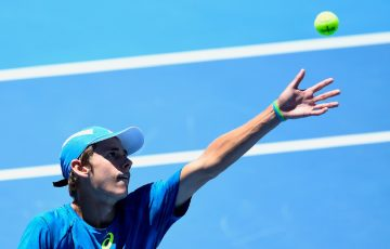 Alex De Minaur of Australia serves during his victory over Benoit Paire