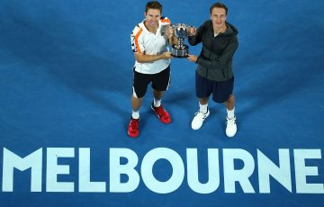 John Peers and Henri Kontinen lift the Australian Open men's doubles trophy.