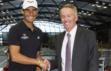 Rafael Nadal is greeted by Greg Tiley.
