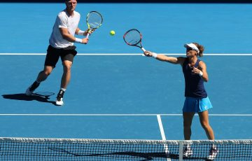 Sam Stosur and Sam Groth in mixed doubles action at Melbourne Park.