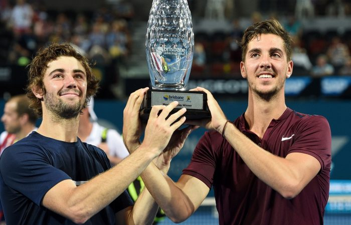 Australia's Thanasi Kokkinakis (right) and Jordan Thompson pose with the winning trophy at the Brisbane International