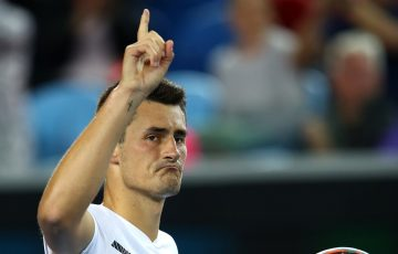 Bernard Tomic of Australia celebrates winning his second round match.