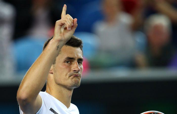 Bernard Tomic of Australia celebrates winning his second round match.