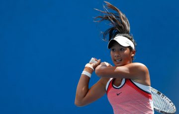 MELBOURNE, AUSTRALIA - JANUARY 19:  Priscilla Hon of Australia plays a backhand in her first round match against Annika Beck of Germany during day two of the 2016 Australian Open at Melbourne Park on January 19, 2016 in Melbourne, Australia.  (Photo by Darrian Traynor/Getty Images)