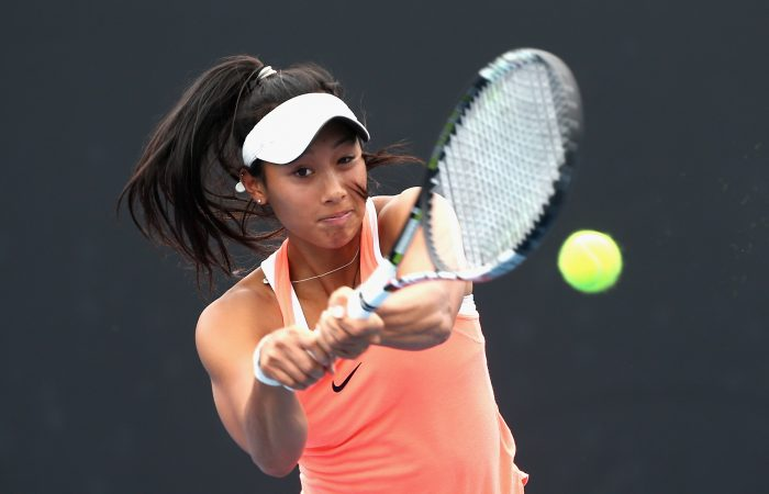 MELBOURNE, AUSTRALIA - DECEMBER 13:  Priscilla Hon of Australia plays a backhand in her singles match during the Australian Open December Showdown  at Melbourne Park on December 13, 2016 in Melbourne, Australia.  (Photo by Robert Prezioso/Getty Images)