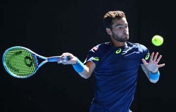MELBOURNE, AUSTRALIA - JANUARY 18:  Noah Rubin of the United States plays a forehand in his second round match against Roger Federer of Switzerland on day three of the 2017 Australian Open at Melbourne Park on January 18, 2017 in Melbourne, Australia.  (Photo by Michael Dodge/Getty Images)