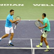 Nick Kyrgios (R) and Nenad Zimonjic combined to beat Bob and Mike Bryan in the first round of men's doubles at Indian Wells; Getty Images