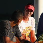 Ajla Tomljanovic (R) and Nick Kyrgios share a laugh during practice; Getty Images