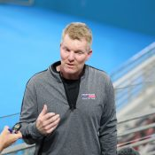 LEADER: American captain Jim Courier speaks about his team to media; SMP Images