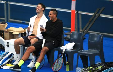GOOD SPIRITS: Jordan Thompson and Nick Kyrgios share a laugh during practice; SMP Images