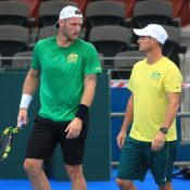 HELPFUL ADVICE: Sam Groth and captain Lleyton Hewitt talk tactics during a practice session; SMP Images