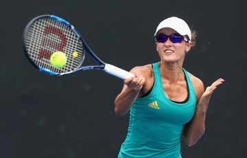 Arina Rodionova of Australia plays a forehand